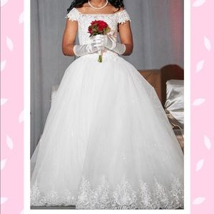 Formal white gown includes slip.